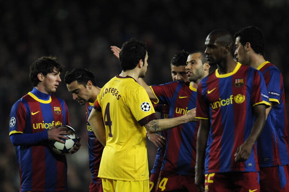 BARCELONA, SPAIN - MARCH 08:  Cesc Fabregas of Arsenal argues with players of Barcelona during the UEFA Champions League round of 16 second leg match between Barcelona and Arsenal at the Camp Nou stadium on March 8, 2011 in Barcelona, Spain. Barcelona won