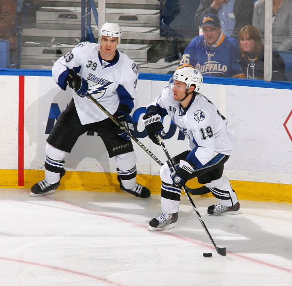 BUFFALO, NY - APRIL 05: Dominic Moore #19 and Mike Lundin #39  of the Tampa Bay Lightning skate against the Buffalo Sabres  at HSBC Arena on April 5, 2011 in Buffalo, New York.  (Photo by Rick Stewart/Getty Images)