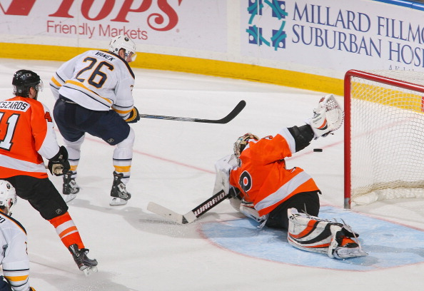 BUFFALO, NY - APRIL 08: Thomas Vanek #26 of the Buffalo Sabres gets the puck behind Sergei Bobrovsky #35 of the Philadelphia Flyers for the game winning goal in overtime at HSBC Arena on April 8, 2011 in Buffalo, New York. Buffalo won 4-3 in overtime. (Ph