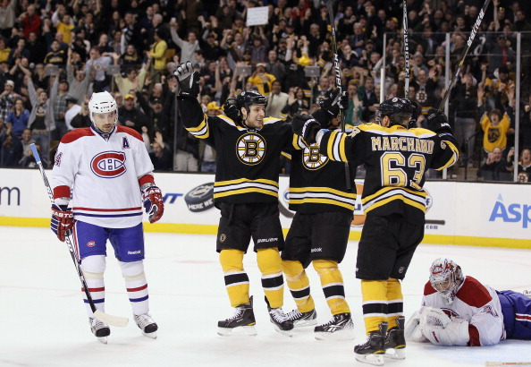 BOSTON, MA - MARCH 24:  Gregory Campbell #11 of the Boston Bruins celebrates his goal with teammate Brad Marchand #63 as Carey Price #31 and Tomas Plekanec #14 of the Montreal Canadiens look on March 24, 2011 at the TD Garden in Boston, Massachusetts.  (P