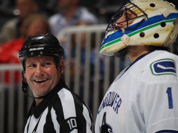 ATLANTA, GA - MARCH 25: Referee Paul Devorski #10 chats with Roberto Luongo #1 of the Vancouver Canucks  at the Philips Arena on March 25, 2011 in Atlanta, Georgia.  (Photo by Bruce Bennett/Getty Images)