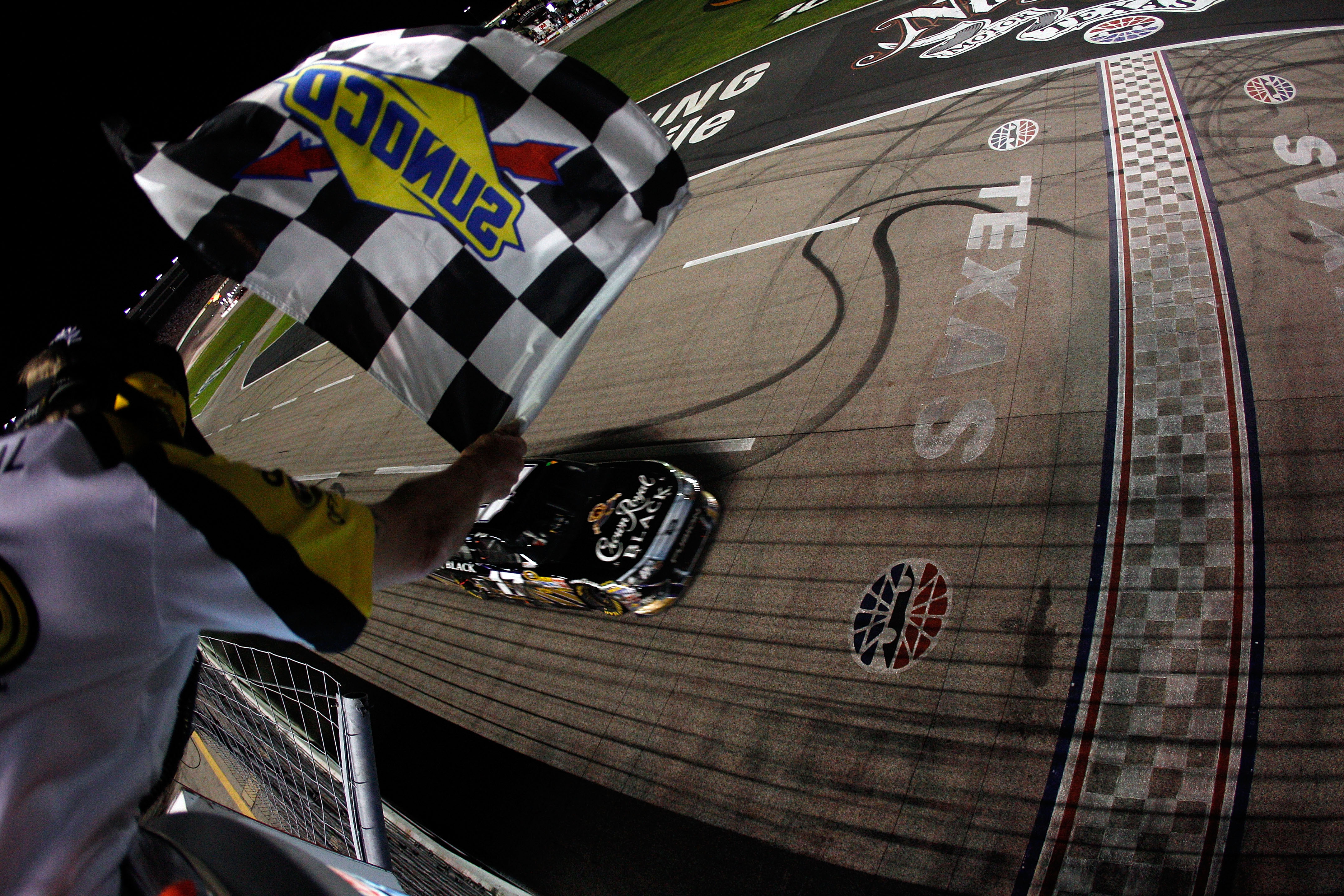 FORT WORTH, TX - APRIL 09:  Matt Kenseth, driver of the #17 Crown Royal Black Ford, crosses the finish line to win the NASCAR Sprint Cup Series Samsung Mobile 500 at Texas Motor Speedway on April 9, 2011 in Fort Worth, Texas.  (Photo by Chris Graythen/Get