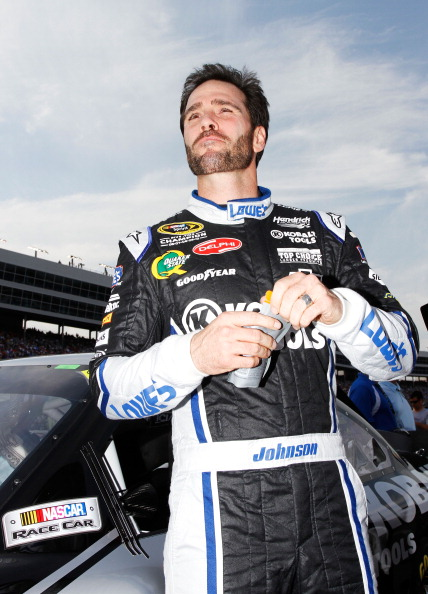 FORT WORTH, TX - APRIL 09:  Jimmie Johnson, driver of the #48 Lowe's/Kobalt Tools Chevrolet, stands on the grid prior to the start of the NASCAR Sprint Cup Series Samsung Mobile 500 at Texas Motor Speedway on April 9, 2011 in Fort Worth, Texas.  (Photo by