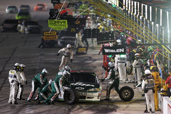 FORT WORTH, TX - APRIL 09:  Dale Earnhardt Jr. pits the #88 Amp Energy/National Guard Chevrolet during the NASCAR Sprint Cup Series Samsung Mobile 500 at Texas Motor Speedway on April 9, 2011 in Fort Worth, Texas.  (Photo by Jonathan Ferrey/Getty Images f