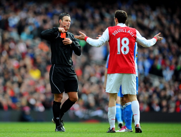 LONDON, ENGLAND - JANUARY 30:  Sebastien Squillaci #30 of Arsenal reacts as he is shown a straight red card by Referee Mark Clattenburg after his foul on Jack Hunt of Huddersfield during the FA Cup sponsored by E.ON fourth round match between Arsenal and