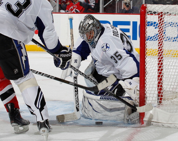 NEWARK, NJ - MARCH 02:  Goalie Dwayne Roloson #35 of the Tampa Bay Lightning makes a save against the New Jersey Devils during the second period of an NHL hockey game at the Prudential Center on March 2, 2011 in Newark, New Jersey. Devils won 2-1. (Photo