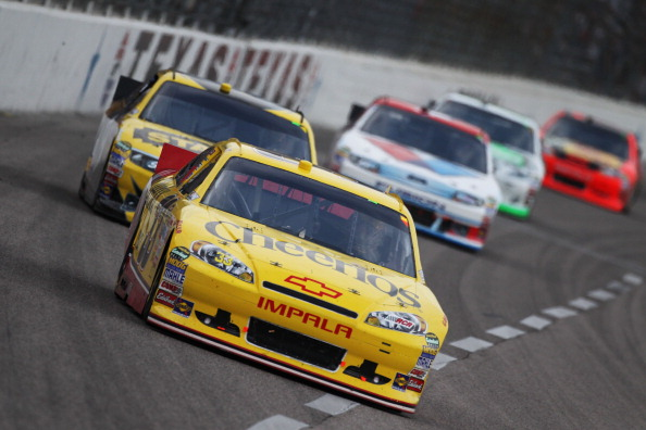 FORT WORTH, TX - APRIL 09:  Clint Bowyer, driver of the #33 Cheerios/Hamburger Helper Chevrolet, leads a group of cars during the NASCAR Sprint Cup Series Samsung Mobile 500 at Texas Motor Speedway on April 9, 2011 in Fort Worth, Texas.  (Photo by Jonatha