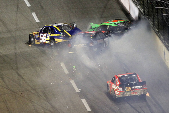 FORT WORTH, TX - APRIL 09:  Martin Truex Jr., driver of the #56 NAPA Toyota, Mark Martin, driver of the #5 GoDaddy.com Chevrolet, and Regan Smith, driver of the #78 farmamerican.org Chevrolet, crash on the backstretch as Jamie McMurray, driver of the #1 B