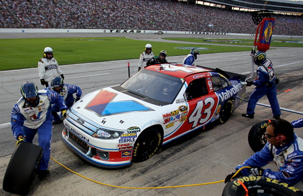 FORT WORTH, TX - APRIL 09:  A.J. Allmendinger pits the #43 Valvoline Ford during the NASCAR Sprint Cup Series Samsung Mobile 500 at Texas Motor Speedway on April 9, 2011 in Fort Worth, Texas.  (Photo by Jason Smith/Getty Images for NASCAR)