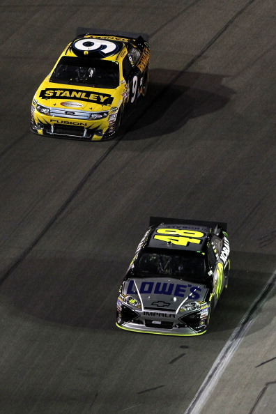 FORT WORTH, TX - APRIL 09:  Jimmie Johnson, driver of the #48 Lowe's Chevrolet, and Marcos Ambrose, driver of the #9 Stanley Ford, drive during the NASCAR Sprint Cup Series Samsung Mobile 500 at Texas Motor Speedway on April 9, 2011 in Fort Worth, Texas.