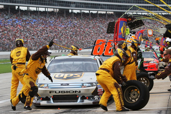FORT WORTH, TX - APRIL 09:  David Ragan, driver of the #6 UPS Freight Ford, makes a pit stop during the NASCAR Sprint Cup Series Samsung Mobile 500 at Texas Motor Speedway on April 9, 2011 in Fort Worth, Texas.  (Photo by Jerry Markland/Getty Images for N