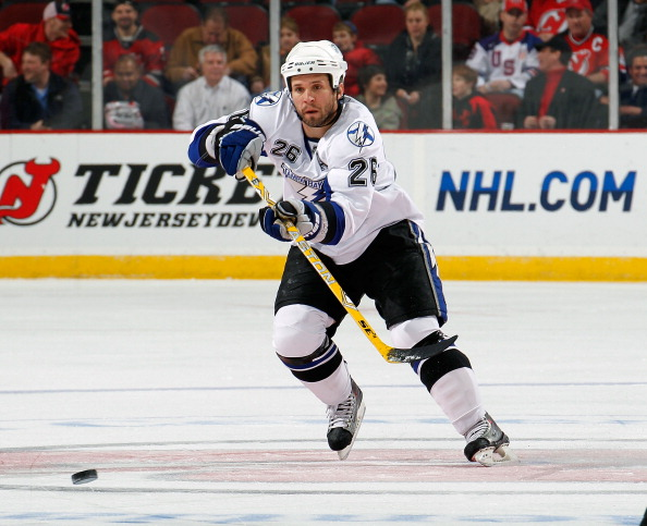 NEWARK, NJ - MARCH 02:  Martin St. Louis #26 of the Tampa Bay Lightning passes during an NHL hockey game against the New Jersey Devils at the Prudential Center on March 2, 2011 in Newark, New Jersey.  (Photo by Paul Bereswill/Getty Images)