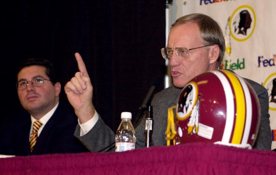 4 Jan 2001:  New head coach Marty Schottenheimer of the Washington Redskins fields questions from the media as team owner Daniel Snyder (left) look on during a press conference to announce the signing of Schottenheimer's four-year ten million dollar contr