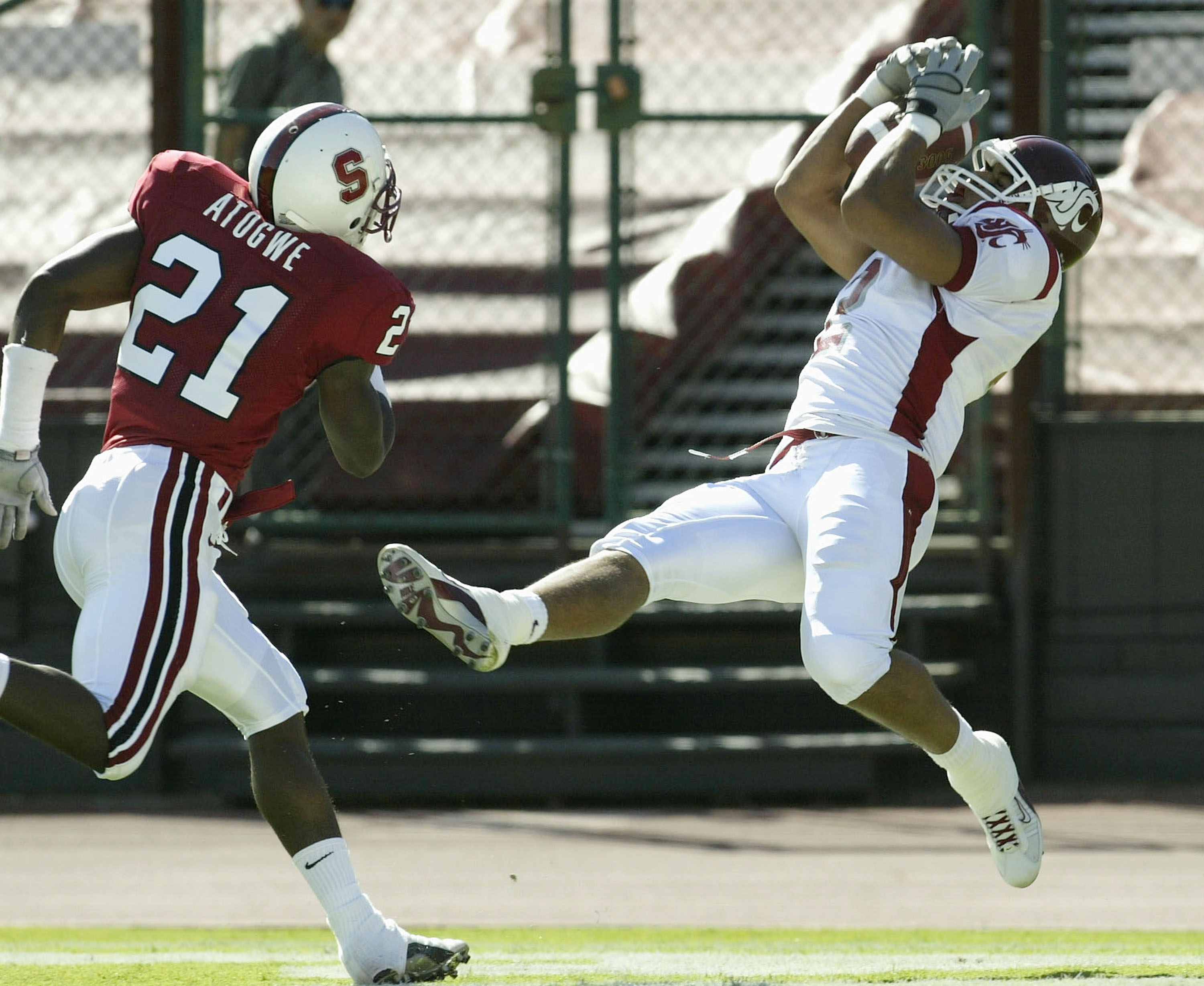 PALO ALTO, CA  - OCTOBER 18:  Wide receiver Chris Jordan #2 of the Washington State Cougars makes a touchdown catch on the game's first series as safety Oshiomogho Atogwe #21 of the Stanford Cardinal defends on October 18, 2003 at Stanford Stadium in Palo
