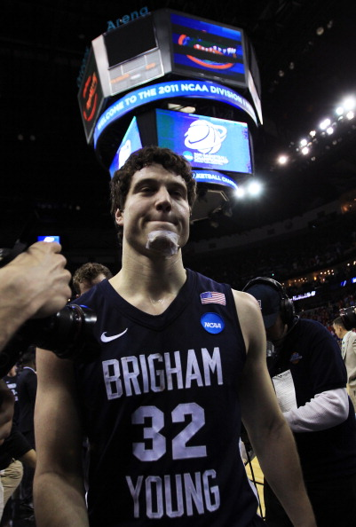 NEW ORLEANS, LA - MARCH 24:  Jimmer Fredette #32 of the Brigham Young Cougars walks off of the court rejected after their 74 to 83 loss to the Florida Gators in the Southeast regional of the 2011 NCAA men's basketball tournament at New Orleans Arena on Ma