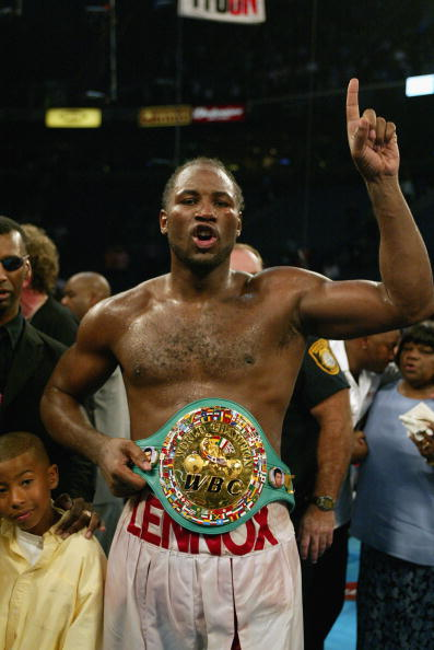 MEMPHIS, TN - JUNE 8:  Lennox Lewis celebrates with this championship belts after knocking out Mike Tyson in the 8th round during their WBC/IBF heavyweight championship bout on June 8, 2002 at The Pyramid in Memphis, Tennessee.  (Photo by Al Bello/Getty I