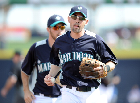 PEORIA, AZ - MARCH 01:  Jack Wilson #2 of the Seattle Mariners heads off the field after an out against the Texas Rangers during spring training at Peoria Stadium on March 1, 2011 in Peoria, Arizona.  (Photo by Harry How/Getty Images)