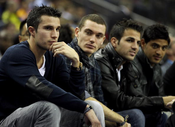 LONDON, ENGLAND - OCTOBER 04:  Arsenal footballers (L-R) Robin van Persie, Thomas Vermaelen, Francesc Fabregas and Carlos Vela during the NBA Europe Live match between the Los Angeles Lakers and the Minnesota Timberwolves at the O2 arena on October 4, 201
