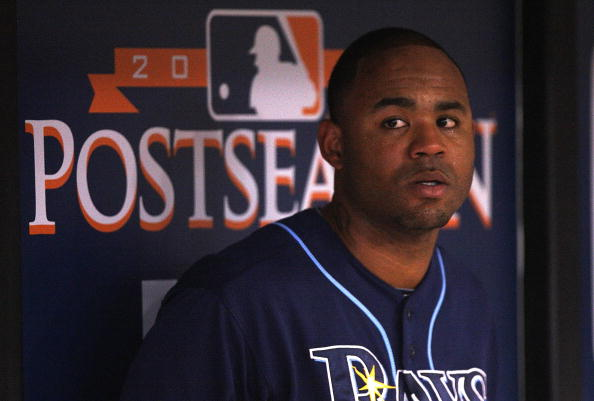 ST PETERSBURG, FL - OCTOBER 07:  Carl Crawford #13 the Tampa Bay Rays waits in the dugout during Game 2 of the ALDS against the Texas Rangers at Tropicana Field on October 7, 2010 in St. Petersburg, Florida.  (Photo by Mike Ehrmann/Getty Images)