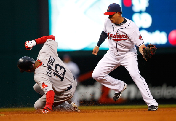 CLEVELAND - APRIL 06:  Carl Crawford #13 of the Boston Red Sox steals second base in front of Orlando Cabrera #20 of the Cleveland Indians during the game on April 6, 2011 at Progressive Field in Cleveland, Ohio.  (Photo by Jared Wickerham/Getty Images)