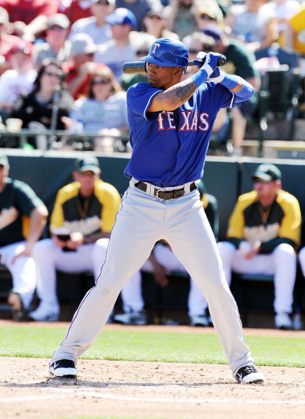 PHOENIX, AZ - MARCH 04:  Engel Beltre #43 of the Texas Rangers gets ready in the batters box against the Oakland Athletics at Phoenix Municipal Stadium on March 4, 2011 in Phoenix, Arizona.  (Photo by Norm Hall/Getty Images)