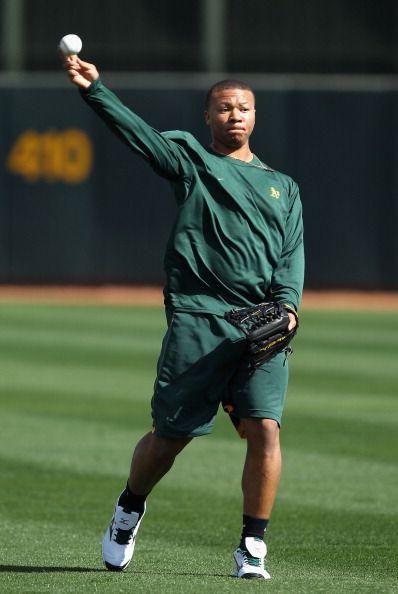 PHOENIX, AZ - FEBRUARY 16:  Michael Choice #71 of the Oakland Athletics warms up during a MLB spring training practice at Phoenix Municipal Stadium on February 16, 2011 in Phoenix, Arizona.  (Photo by Christian Petersen/Getty Images)