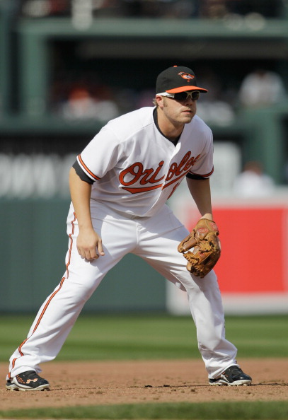 BALTIMORE, MD - APRIL 04:  Third baseman Mark Reynolds #12 of the Baltimore Orioles against the Detroit Tigers during opening day at Oriole Park at Camden Yards on April 4, 2011 in Baltimore, Maryland.  (Photo by Rob Carr/Getty Images)