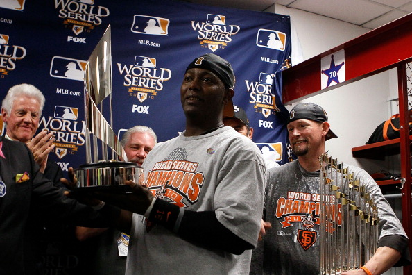 ARLINGTON, TX - NOVEMBER 01:  World Series MVP Edgar Renteria of the San Francisco Giants receives his MVP trophy in the locker room after the Giants won 3-1 against the Texas Rangers in Game Five of the 2010 MLB World Series at Rangers Ballpark in Arling