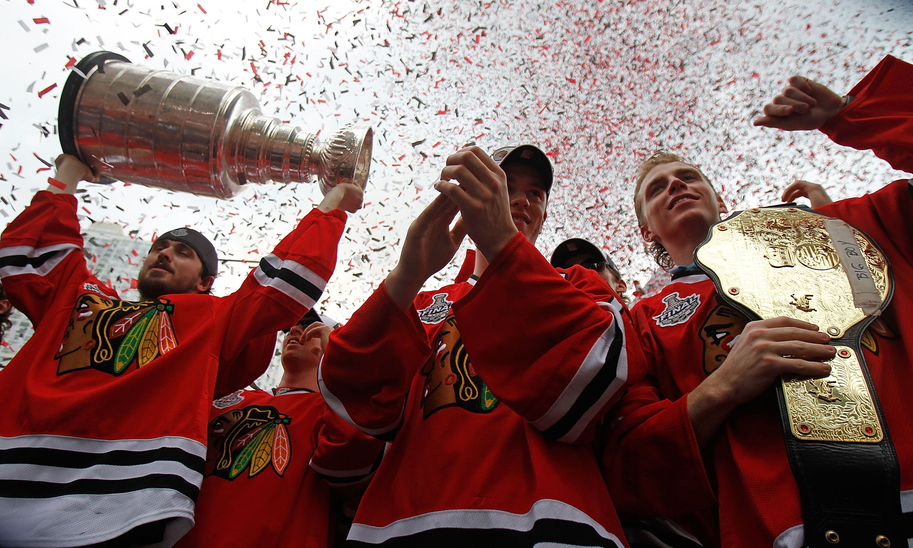 CHICAGO - JUNE 11: (L-R) Dave Bolland #36, Jonathan Toews #19, and Patrick Kane #88 celebrate with the crowd during the Chicago Blackhawks Stanley Cup victory parade and rally on June 11, 2010 in Chicago, Illinois. (Photo by Jonathan Daniel/Getty Images)