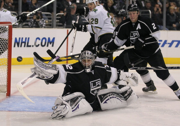 LOS ANGELES, CA - APRIL 02:  Goaltender Jonathan Quick #32 of the Los Angeles Kings lunges for the puck as Matt Greene #2 defends in the third period against the Dallas Stars at Staples Center on April 2, 2011 in Los Angeles, California. The Kings defeate