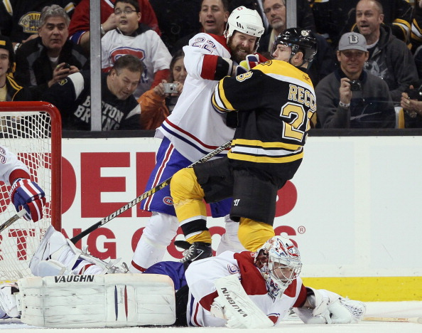 BOSTON, MA - MARCH 24:  Paul Mara #22 of the Montreal Canadiens AND Mark Recchi #28 of the Boston Bruins get in a shoving match as Carey Price #31 stops a shot on March 24, 2011 at the TD Garden in Boston, Massachusetts.  (Photo by Elsa/Getty Images)