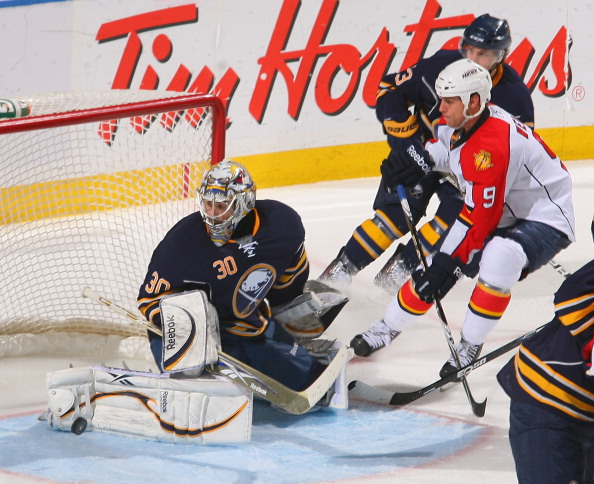 BUFFALO, NY - MARCH 25: Ryan Miller #30 of the Buffalo Sabres makes a save on Stephen Weiss #9 of the Florida Panthers at HSBC Arena on March 25, 2011 in Buffalo, New York. Buffalo won 4-2. (Photo by Rick Stewart/Getty Images)