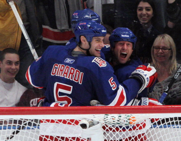 NEW YORK, NY - APRIL 09:  (L-R) Dan Girardi #5 and Vaclav Prospal #20 of the New York Rangers celebrate Prospal's goal at 10:49 of the third period against the New Jersey Devils at Madison Square Garden on April 9, 2011 in New York City. The Rangers defea