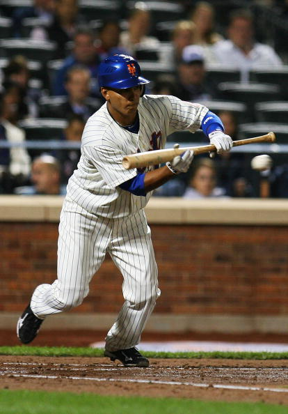 NEW YORK - SEPTEMBER 15:  Ruben Tejada #11 the New York Mets bunts against the Pittsburgh Pirates on September 15, 2010 at Citi Field in the Flushing neighborhood of the Queens borough of New York City.  (Photo by Andrew Burton/Getty Images)