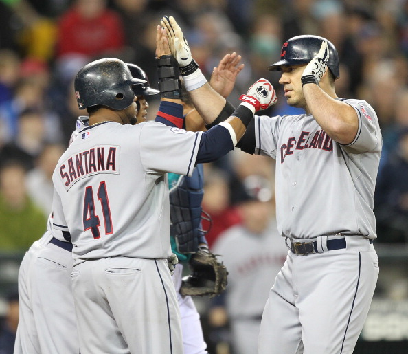 SEATTLE - APRIL 08:  Travis Hafner #48 (R) of the Cleveland Indians is congratulated by Carlos Santana #41 and Shin-Soo Choo #17 after hitting a three run homer against the Seattle Mariners during the Mariners' home opener at Safeco Field on April 8, 2011