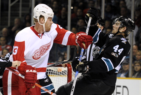 SAN JOSE, CA - MARCH 3: Johan Franzen #93 of the Detroit Red Wings takes a swing at Marc-Edouard Vlasic #44 of the San Jose Sharks and both get a four-minute roughing penalty in the first period of an NHL hockey game at the HP Pavilion on March 3, 2011 in