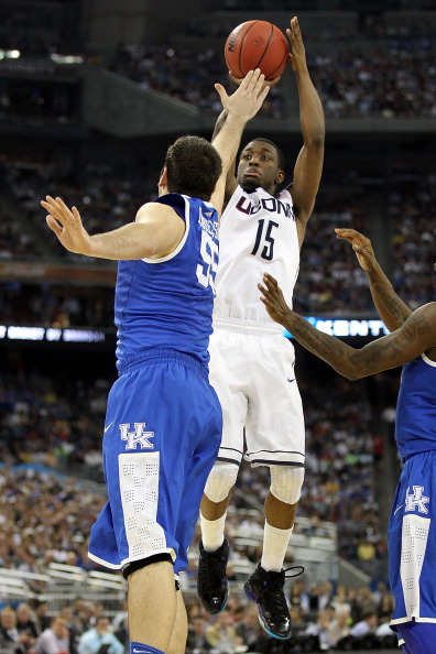 HOUSTON, TX - APRIL 02:  Kemba Walker #15 of the Connecticut Huskies shoots over Josh Harrellson #55 of the Kentucky Wildcats during the National Semifinal game of the 2011 NCAA Division I Men's Basketball Championship at Reliant Stadium on April 2, 2011