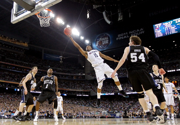 HOUSTON, TX - APRIL 04:  Kemba Walker #15 of the Connecticut Huskies goes to the basket against Matt Howard #54 and Shelvin Mack #1 of the Butler Bulldogs during the National Championship Game of the 2011 NCAA Division I Men's Basketball Tournament at Rel