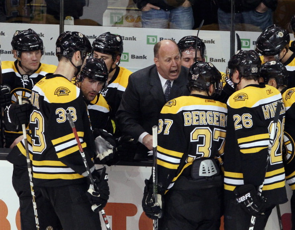 BOSTON, MA - JANUARY 13:  Head coach Claude Julien of the Boston Bruins talks with his players during a time out in the third period against the Philadelphia Flyers on January 13, 2011 at the TD Garden in Boston, Massachusetts. The Bruins defeated the Fly