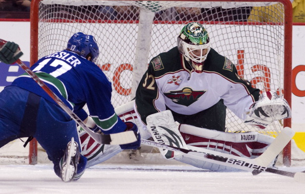 VANCOUVER, CANADA - APRIL 7: Ryan Kesler #17 of the Vancouver Canucks dives to try and shoot the puck before reaching goalie Niklas Backstrom #32 of the Minnesota Wild during the first period in NHL action on April 07, 2011 at Rogers Arena in Vancouver, B