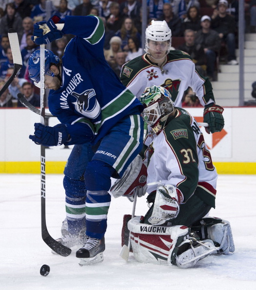 VANCOUVER, CANADA - APRIL 7: Ryan Kesler #17 of the Vancouver Canucks tries to redirect the puck past goalie Niklas Backstrom #32 of the Minnesota Wild during the second period in NHL action on April 07, 2011 at Rogers Arena in Vancouver, BC, Canada.  (Ph