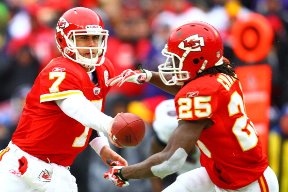 KANSAS CITY, MO - JANUARY 09:  Quarterback Matt Cassel #7 of the Kansas City Chiefs hands the ball off to running back Jamaal Charles #25 against the Baltimore Ravens during their 2011 AFC wild card playoff game at Arrowhead Stadium on January 9, 2011 in