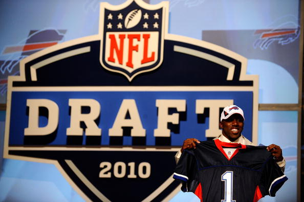NEW YORK - APRIL 22:  C.J. Spiller from the Clemson Tigers holds up a Buffalo Bills jersey after he was selected number 9 overall by the Bills during the first round of the 2010 NFL Draft at Radio City Music Hall on April 22, 2010 in New York City.  (Phot