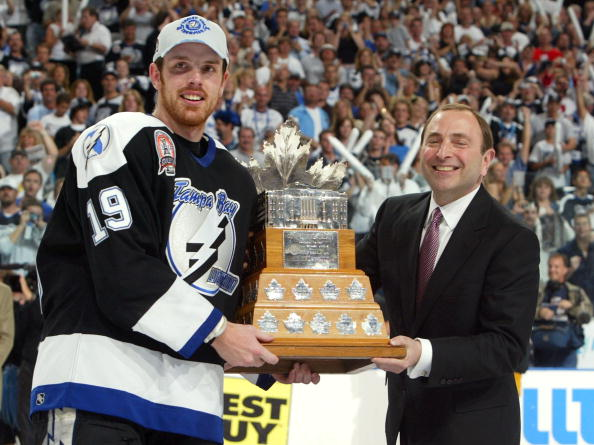 TAMPA, FL - JUNE 7:  Brad Richards #19 of the Tampa Bay Lightning receives the Conn Smythe MVP trophy from NHL Commissioner Gary Bettman after defeating the Calgary Flames 2-1 in game seven of the NHL Stanley Cup Finals on June 7, 2004 at the St. Pete Tim