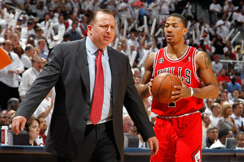 ATLANTA, GA - MAY 12:  Derrick Rose #1 walks off the court as Tom Thibodeau of the Chicago Bulls reacts after calling a timeout against the Atlanta Hawks in Game Six of the Eastern Conference Semifinals in the 2011 NBA Playoffs at Phillips Arena on May 12