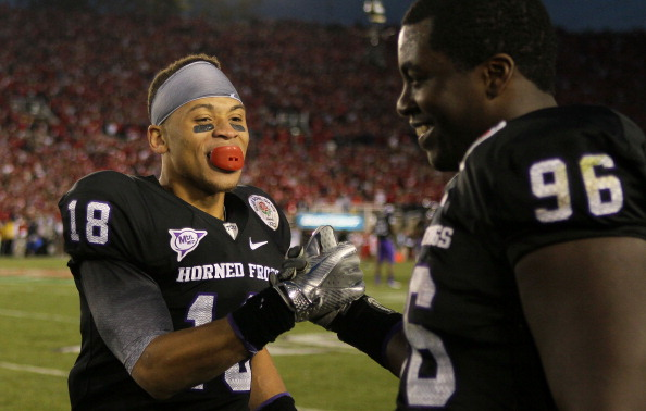 PASADENA, CA - JANUARY 01:  Cornerback Travaras Battle #18 of the TCU Horned Frogs celebrates with Wayne Daniels #96 in the final moments of their 21-19 win over the Wisconsin Badgers in the 97th Rose Bowl game on January 1, 2011 in Pasadena, California.