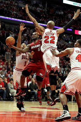 CHICAGO, IL - MAY 26:  LeBron James #6 of the Miami Heat drives for a shot attempt against Taj Gibson #22 and Derrick Rose #1 of the Chicago Bulls in Game Five of the Eastern Conference Finals during the 2011 NBA Playoffs on May 26, 2011 at the United Cen