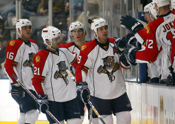 TORONTO - FEBRUARY 5:  (L-R) Nathan Horton #16, Cory Murphy #21, David Booth #10 and Stephen Weiss #9 of the Florida Panthers skate by their team bench to celebrate with teammates during a break in NHL game action against the Toronto Maple Leafs at the Ai