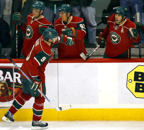 ST. PAUL, MN - OCTOBER 21:  Mikko Koivu #9 of the Minnesota Wild gets high-fives from teammates Marian Gaborik #10, Branko Radivojevic #92 and Brian Rolston #12 after scoring in the third period of their game against the Colorado Avalanche at the Xcel Ene