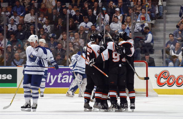 TORONTO - APRIL 21:  Gary Roberts #7 of the Toronto Maple Leafs skates back to center ice as Jeremy Roenick #97 of the Philadelphia Flyers is congratulated by teammates Kim Johnsson #5, Tony Amonte #11, Eric Weinrich #2 and Sami Kapanen #24 after tying th